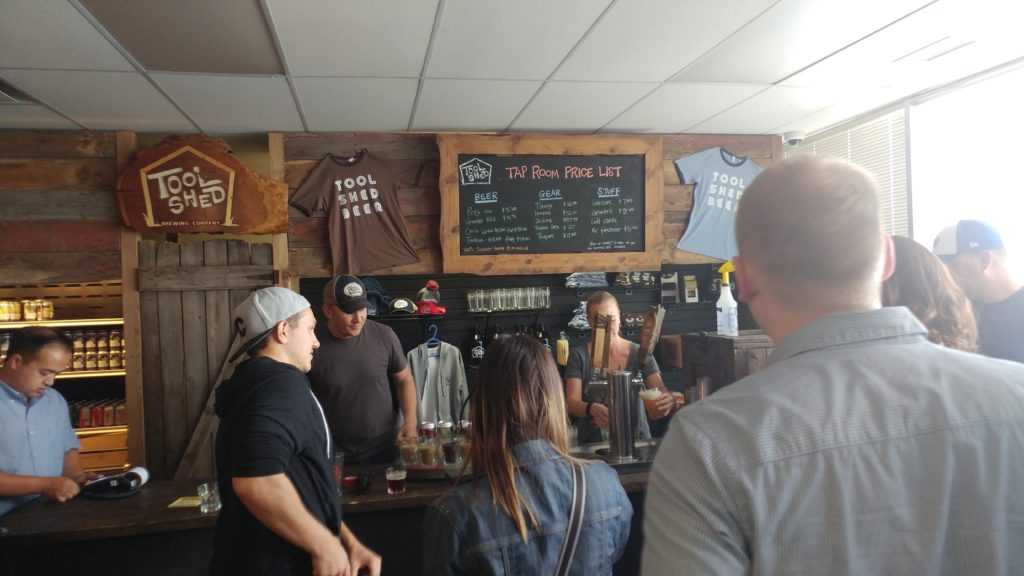 Sampling Beers at Tool Shed Brewing Company Brewery Tour in Calgary