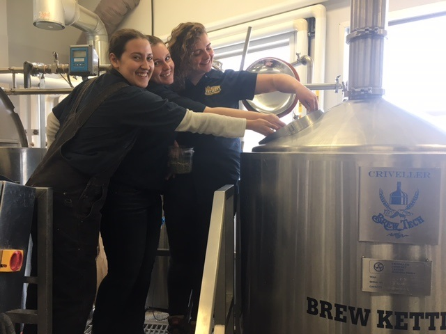 Becca, Emily and Zoei Brewing the Big Boots Brew for Olds College