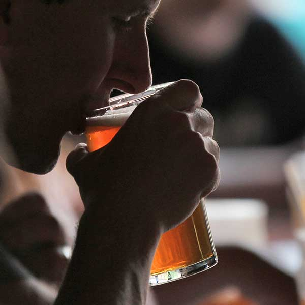 guy-sipping-pint-drinking-beer-free-photography-pub