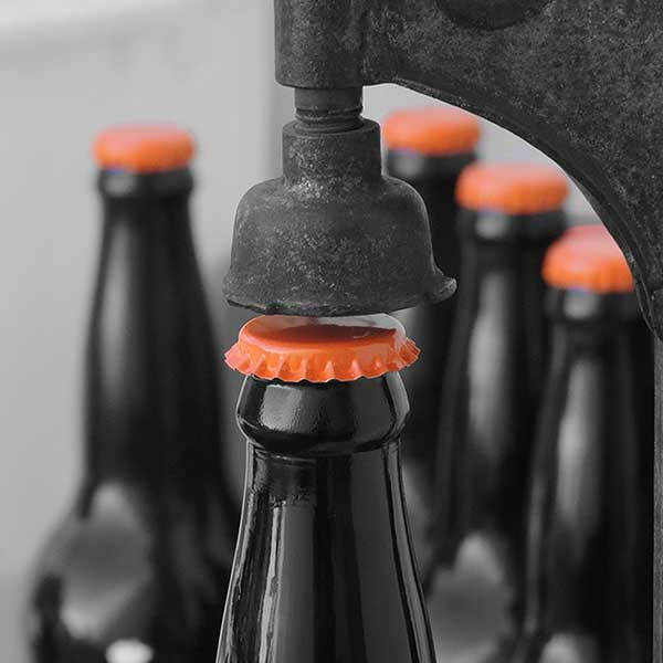 stock-photo-beer-bottle-being-topped-cap-free-image
