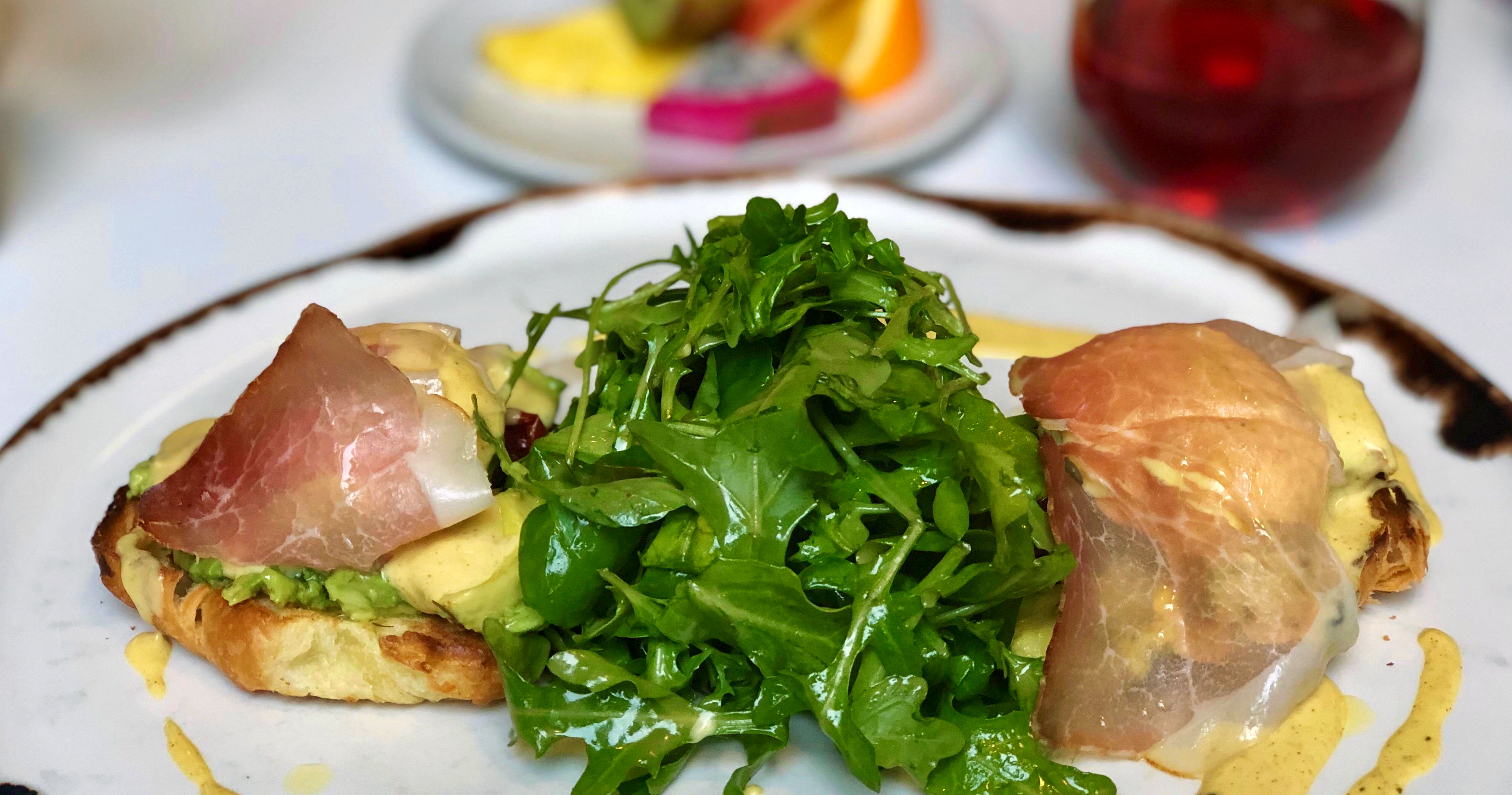 OEB Smoked Boar Speck Benny with Arugula. Image Source: Tracy-Lynne MacLellan, JustWine  | Just Wine