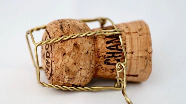 what's the difference between champagne and prosecco? how much pressure is under the cork?